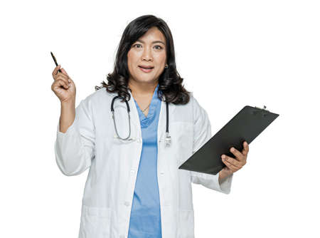 Asian doctor with stethoscope holding pen and clipboard on white background. Standard-Bild