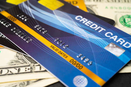Credit card model on US dollar banknotes, Finance development, Banking Account, Statistics, Investment Analytic research data economy, Stock exchange trading, Business company concept. Standard-Bild