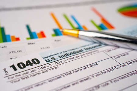 Bangkok, Thailand - June 1, 2020 Tax Return form 1040 and dollar banknote, U.S. Individual Income.