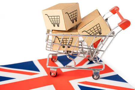 Box with shopping cart logo and United Kingdom flag, Import Export Shopping online or eCommerce finance delivery service store product shipping, trade, supplier concept. 版權商用圖片