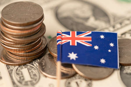 Stack of coins with Australia flag on white background. 版權商用圖片