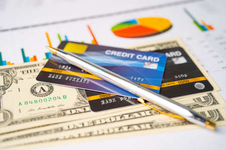 Credit card on chart and graph paper. Finance development, Banking Account, Statistics, Investment Analytic research data economy, Stock exchange trading, Business company concept.
