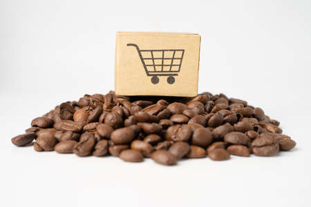 Box with shopping cart symbol on coffee beans, Import Export Shopping online or eCommerce delivery service store product shipping, trade, supplier concept.