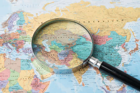 Bangkok, Thailand - August 01, 2020 Europe, Magnifying glass close up with colorful world map, Magnifying glass close up with colorful world map 新闻类图片