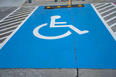 Blue Handicap at parking car sign outdoors for Disabled, Wheelchair or elder old or cannot self help people