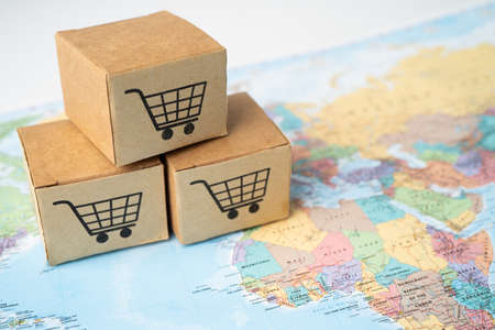 Shopping cart  on box on world globe map background. Banking Account, Investment Analytic research data economy, trading, Business import export transportation online company concept.