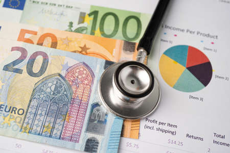 Stethoscope and EU banknotes on chart or graph paper, Financial, account, statistics and business data  medical health concept.