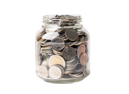 Save money coins in grass jar, Business finance investment concept.