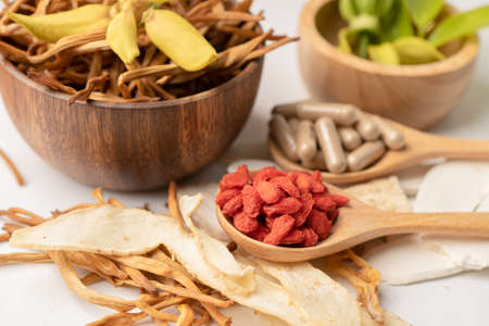 Chinese herb medicine with goji berries for good healthy.