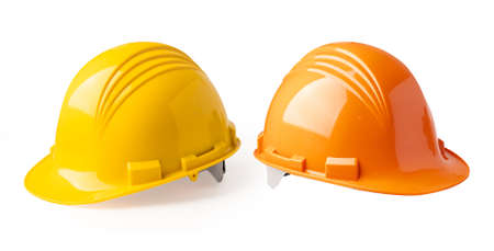 Yellow and Orange color construction helmet isolated on white background, engineer safety concept.