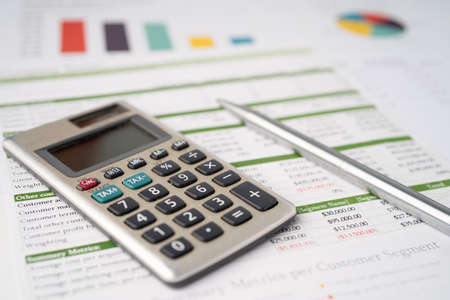Calculator on graph paper. Finance development, Banking Account, Statistics, Investment Analytic research data economy, Stock exchange trading, Business company concept. Archivio Fotografico