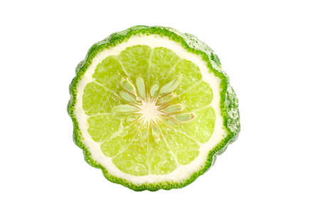 Fresh bergamot fruit with cut in half on white background with clipping path.