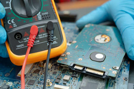 technician repairing inside of hard disk by soldering iron. Integrated Circuit. the concept of data, hardware, technician and technology. Stock fotó