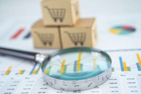 Magnifying glass and shopping cart logo on box with graph background. Banking Account, Investment Analytic research data economy, trading, Business import export transportation online company concept.