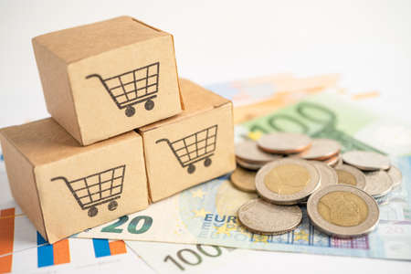 Shopping cart on box with US dollar banknotes, Banking Account, Investment Analytic research data economy, trading, Business import export online company concept.
