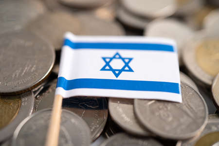 Stack of coins with Israel flag, finance concept.