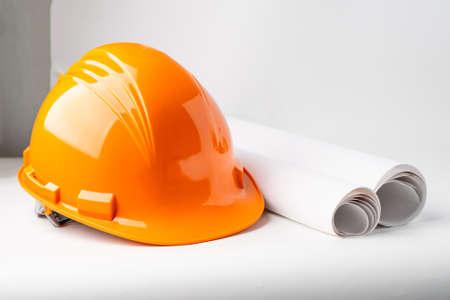 Orange construction helmet isolated on white background, engineer concept.