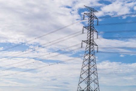 High voltage electric pole with power line electricity engineer distribution station.