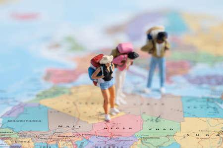 Bangkok, Thailand, July 30, 2021 Miniature people,Backpacker enjoy to discovery journey travel at amazing on world map.