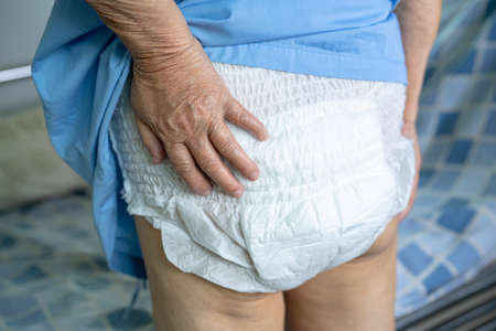 Asian senior or elderly old lady woman patient wearing incontinence diaper in nursing hospital ward, healthy strong medical concept.