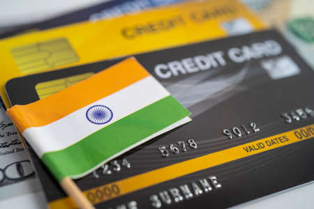 India flag on credit card. Finance development, Banking Account, Statistics, Investment Analytic research data economy, Stock exchange trading, Business company concept.