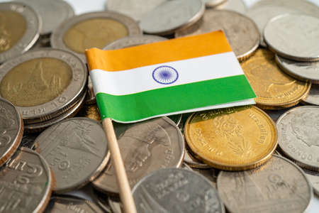 India flag on coins background, finance and accounting, banking concept. Фото со стока