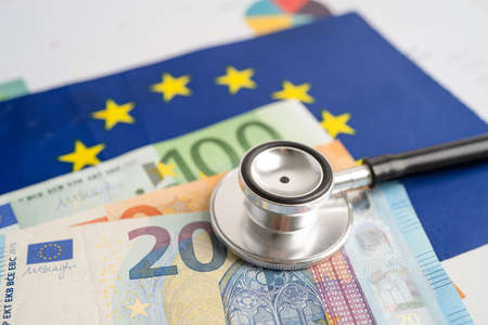 Black stethoscope on EU flag in europe with banknotes money, Business and finance concept.