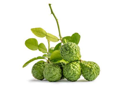 Fresh bergamot fruit or kaffir lime with cut in half on wooden background.