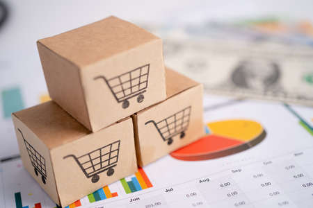 Shopping cart logo on box with US dollar banknotes, Banking Account, Investment Analytic research data economy, trading, Business import export online company concept.