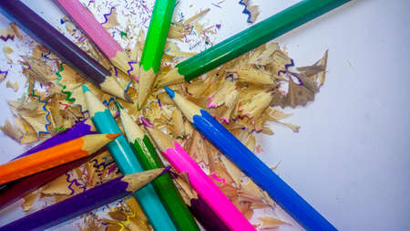 Beautiful assorted colored pencils with shavings  on white background 写真素材