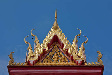 Buddhist temple gable with carved apex photo