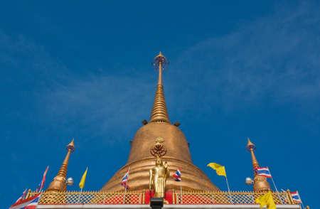 Buddhist golden pagoda in Bangkok, Thailand photo