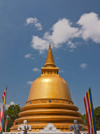 Golden pagoda in Dambulla, Sri Lanka photo