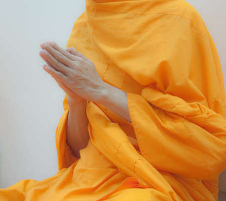 Hands of Buddhist monk praying for the Buddhist photo
