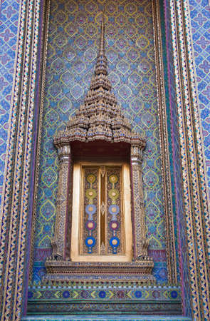 Thai temple door sculpture photo