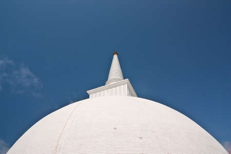 dagoba: Top part of the huge white Mahaseya Stupa (Dagoba) in  Mihintale, Sri Lanka