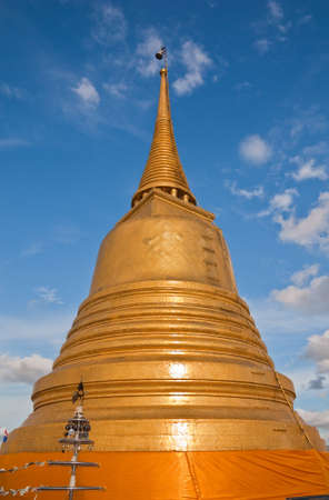 Buddhist golden pagoda in Bangkok, Thailand photo