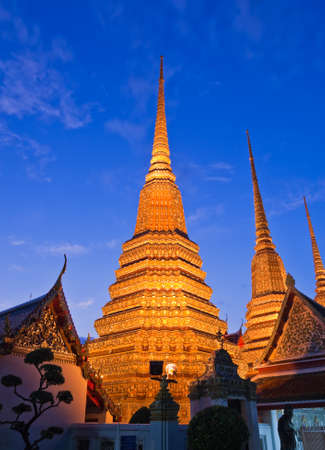 Twilight scene of Buddhist pagoda in Bangkok, Thailand photo
