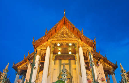 Buddhist church under twilight sky, located in Bangkok, Thailand. photo