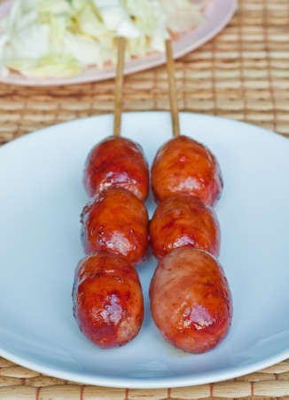 Close-up of Thai style grilled sausage, also call  Sai krok isan   photo