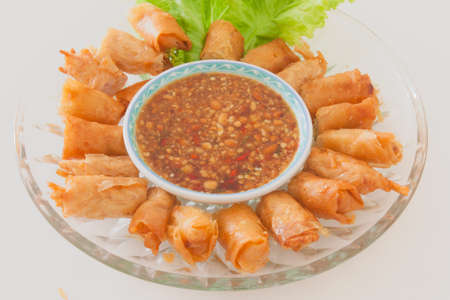 Chinese style fried spring rolls with sweet spicy sauce photo