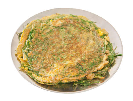 Plate of Thai style omelet with acacia herb photo