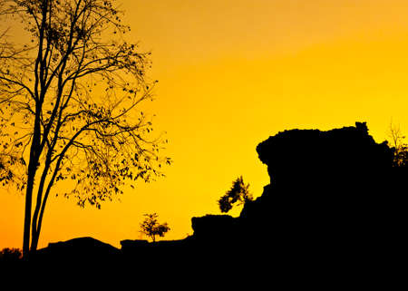 Silhouette view of a small cliff landscape under twilight sky in Thailand photo