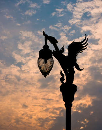 Silhouette view of Thai art style light pole under beautiful twilight sky photo