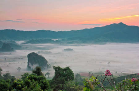 Beautiful landscape of  misty valley and sierra in Thailand photo