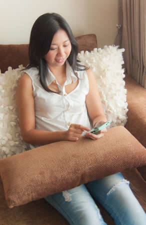 An Asian woman using mobile device photo