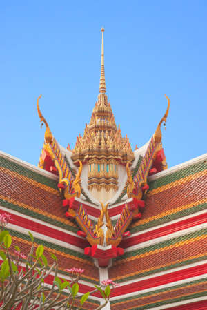 buddhist temple roof: Thai buddhist temple roof gable with tiered and carved apex