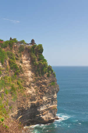 Steep cliff over the ocean at Uluwatu temple, Bali, Indonesia  photo