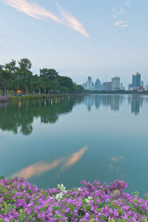 Scenery of a park and Bangkok cityscape in the evening photo