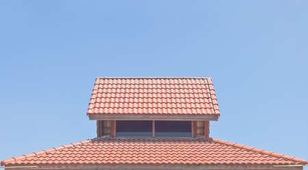 tile of roof: Roof tiles under clear blue sky